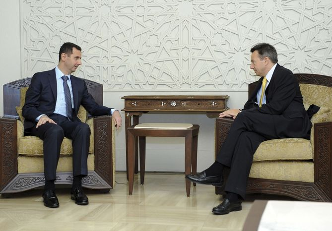 """Syrian President Bashar Assad (left) meets with Peter Maurer, president of the International Committee of the Red Cross, in Damascus, Syria, on Tuesday, Sept. 4, 2012. Mr. Assad told Mr. Maurer that the Red Cross is welcome to operate on the ground in the country as long as it remains """"neutral and independent,"""" the SANA state news agency reported. (AP Photo/SANA)"""