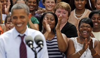 President Obama smiles as supporters applaud during a Sept. 4, 2012, rally at Norfolk State University in Norfolk, Va. (Associated Press)
