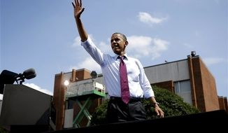 President Obama waves to supporters from the stage after speaking at a campaign event at Norfolk State University on Tuesday, Sept. 4, 2012, in Norfolk, Va. (AP Photo/Pablo Martinez Monsivais)