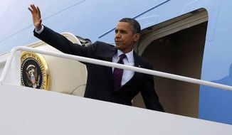 President Barack Obama waves as he boards Air Force One before his departure from Andrews Air Force Base, Md., Tuesday, Sept., 4, 2012. (AP Photo/Pablo Martinez Monsivais)