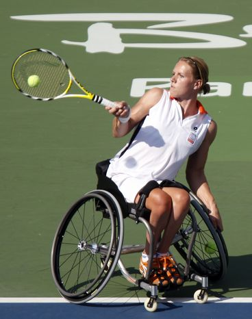 FILE - In this Sept. 15, 2008, file photo, Esther Vergeer of the Netherlands, returns a shot during the wheelchair tennis women's doubles open final at the Beijing 2008 Paralympic Games in Beijing, China. After more than 13 years at No. 1 in the wheelchair tennis rankings and going unbeaten since 2003 with 465 consecutive victories, Vergeer entered the London Paralympics with a solid argument for being the most dominant athlete within a single sport. The 31-year-old Dutchwoman extended that run to 468 matches with a 6-1, 6-0 win against Thailand's Sakhorn Khanthasit in the quarterfinals, Tuesday, Sept. 4, 2012. (AP Photo/Ng Han Guan, File)