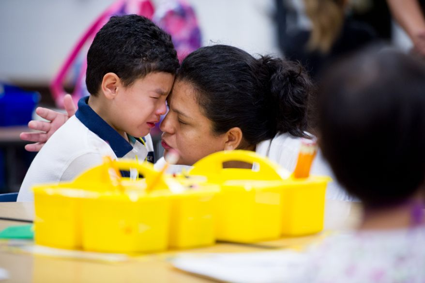 Sandra Mejia comforts her son Carlos Jiron, 5, on his first day of kindergarten at North Springfield Elementary School, Springfield, Va., Tuesday, September 4, 2012. (Andrew Harnik/The Washington Times)