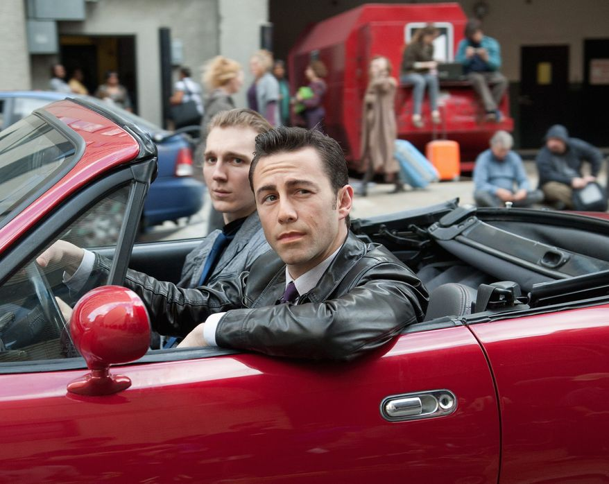 "Joseph Gordon-Levitt (front) and Paul Dano co-star in a scene from the thriller ""Looper."" In its 37th year, the Toronto International Film Festival opens Thursday with the big Hollywood action film, a sci-fi tale also starring Bruce Willis and Emily Blunt. (Sony Pictures Entertainment)"