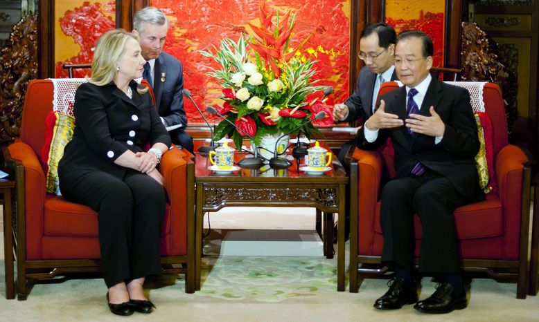 Secretary of State Hillary Rodham Clinton met with Chinese Premier Wen Jiabao and other leaders, but a session with leader-in-waiting Xi Jinping was canceled Wednesday without explanation by her hosts. (Associated Press)