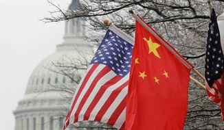 Chinese flags flew in Washington when President Hu Jintao visited in 2011, despite the ongoing rift between the two governments on China's monetary policies, rifts that persist today despite actions by China to realign its currency. (Associated Press)