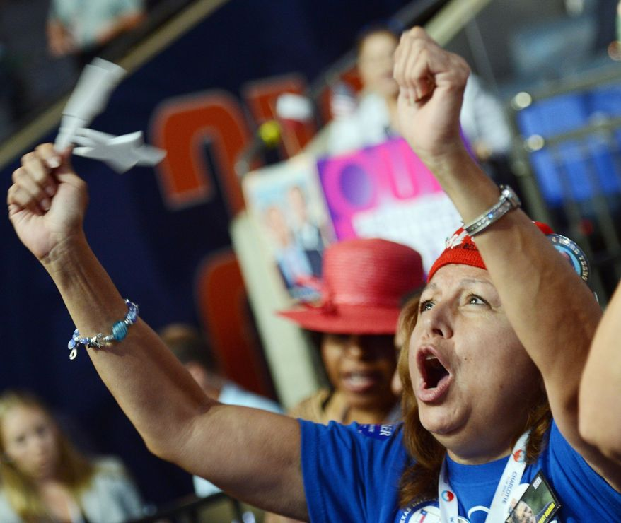 Texas delegate Tina Guerrera, of San Antonio, reacts to remarks by a speaker during the Democratic National Convention in Charlotte, N.C., on Wednesday. (Barbara L. Salisbury/The Washington Times)