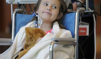 Sierra Jane Downing, 7, from Pagosa Springs, Colo., smiles during a Sept. 5, 2012, news conference at the Rocky Mountain Hospital for Children at Presbyterian/St. Luke's in Denver about her recovery from bubonic plague. It is believed Downing caught the bubonic plague from burying a dead squirrel. (Associated Press)
