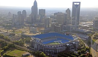 In this file photo, the skyline of Charlotte, N.C., rises behind the Bank of America Stadium (foreground). The city, which hosted the 2012 Democratic convention, is bidding to be the host city for the 2020 Republican convention. (AP Photo/Chuck Burton) **FILE**