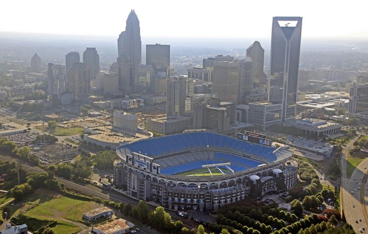 The skyline of Charlotte, N.C., rises behind the Bank of America Stadium (foreground). President Obama's renomination acceptance speech, scheduled for Thursday night at the stadium, has been moved indoors because of concerns about the weather. (AP Photo/Chuck Burton)