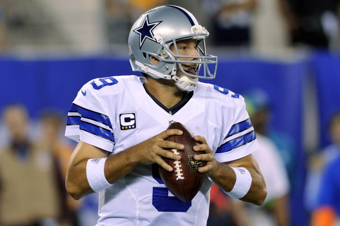 Dallas Cowboys quarterback Tony Romo looks to throw during the first half of an NFL football game against the New York Giants Wednesday, Sept. 5, 2012, in East Rutherford, N.J. (AP Photo/Bill Kostroun)