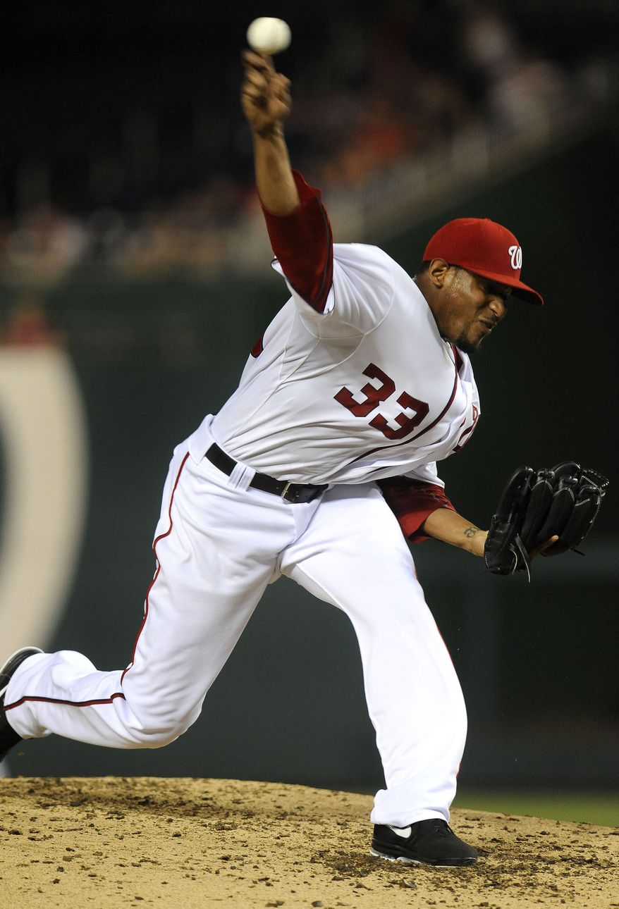 Washington Nationals' Edwin Jackson delivers a pitch in the third inning of the Nationals' 11-5 win against the Chicago Cubs at Nationals Park in Washington on Sept. 4, 2012. (Associated Press)