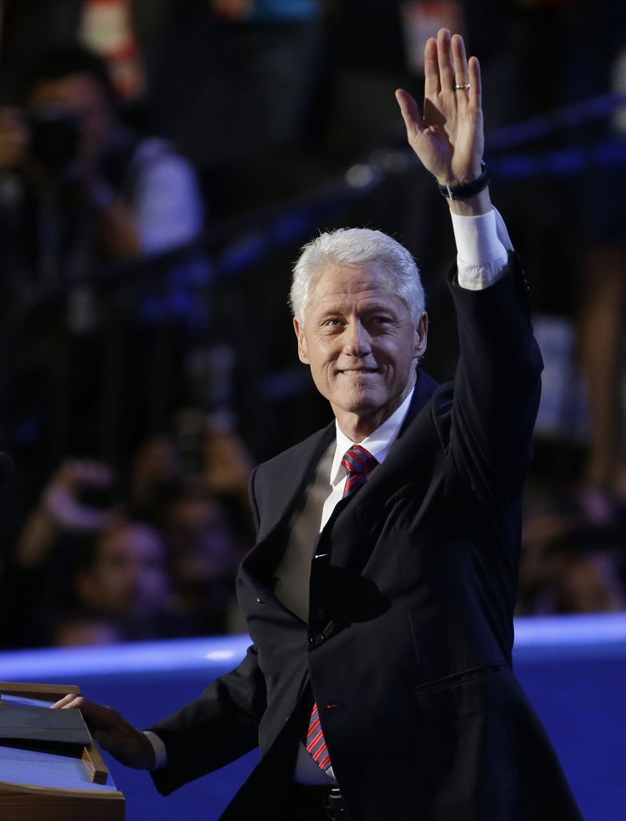Former President Bill Clinton waves to delegates at the Democratic National Convention in Charlotte, N.C., on Sept. 5, 2012. (Associated Press)