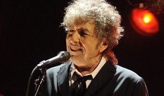 Singer-songwriter Bob Dylan performs in Los Angeles on Thursday, Jan. 12, 2012. (AP Photo/Chris Pizzello)