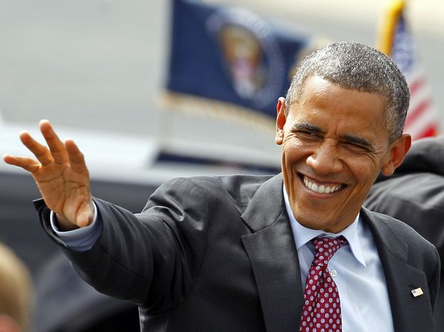 President Obama waves to supporters Sept. 5, 2012, as he arrives at the Charlotte/Douglas International Airport in Charlotte, N.C., for the Democratic National Convention. (Associated Press)