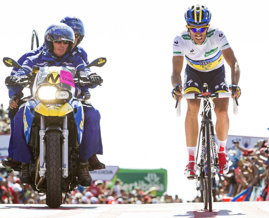 Alberto Contador of Spain crosses the finish line during 12th stage of the Spanish Vuelta cycling race in Dumbria, Spain, Thursday Aug. 30, 2012.  The 21-stage, three week race ends in Madrid on Sept. 9. (AP Photo/Lalo R. Villar)