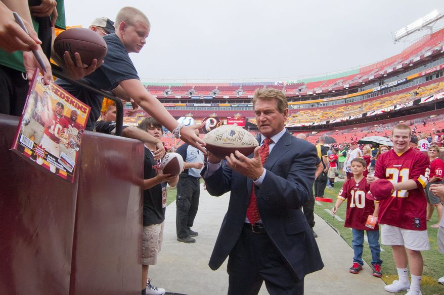 Joe Theismann (signing autographs for fans at FedEx Field on Aug. 25) and Sonny Jurgensen were the darlings of D.C. during their heydays when Washington was synonymous with winning. (Craig Bisacre/The Washington Times)