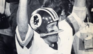 Joe Theismann basked in the glory of the Redskins' first Super Bowl championship, a 27-17 decision over the Miami Dolphins on Jan. 31, 1982.  (Associated Press)