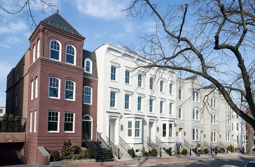 Each custom-designed town home at Wormley Row on Prospect Street Northwest has four levels with 4,900 to 5,600 finished square feet. The homes are base-priced from $3,445,000 to $4,995,000.