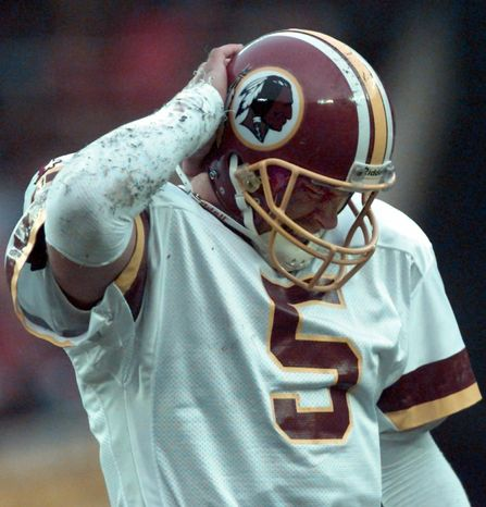 Washington Redskins quarterback Heath Shuler puts his hand to his helmet during the Redskins 14-7 loss to the Philadelphia Eagles Sunday, Nov. 26, 1995 at RFK Stadium. Shuler, starting his first game since the season opener, was 12 for 27 for 164 yards. (AP Photo/Doug Mills)