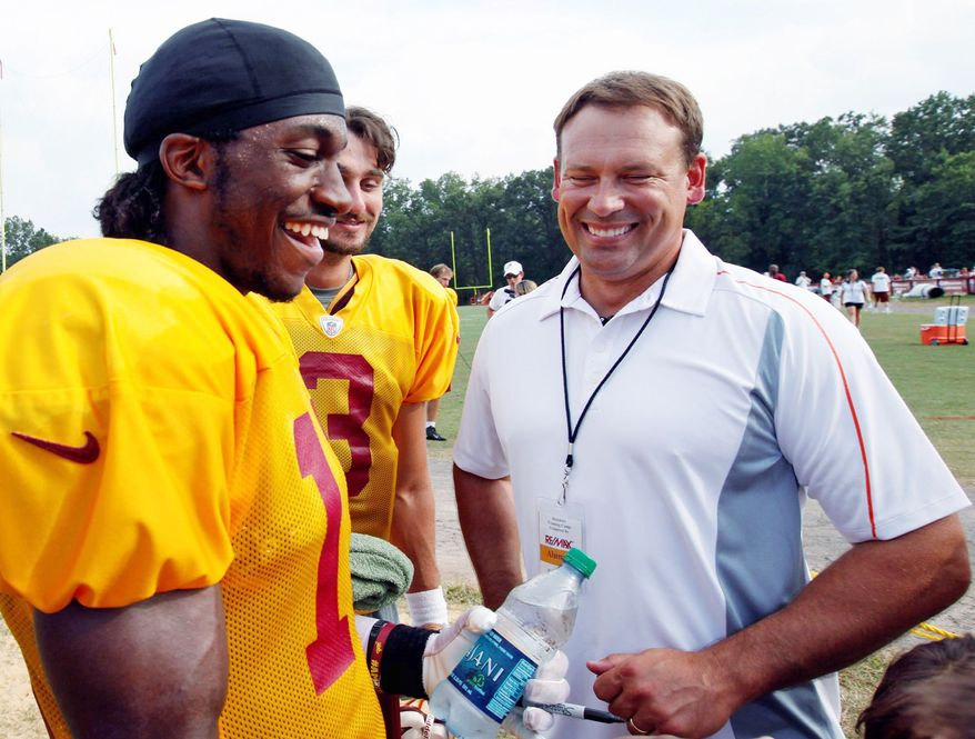 Redskins rookie quarterback Robert Griffin III (left) shares a moment with Heath Shuler, whose career as a congressman has outshined his playing days with the Redskins (below). Shuler never lived up to the hype of being the No. 3 overall pick out of Tennessee in 1994. (Associated Press)
