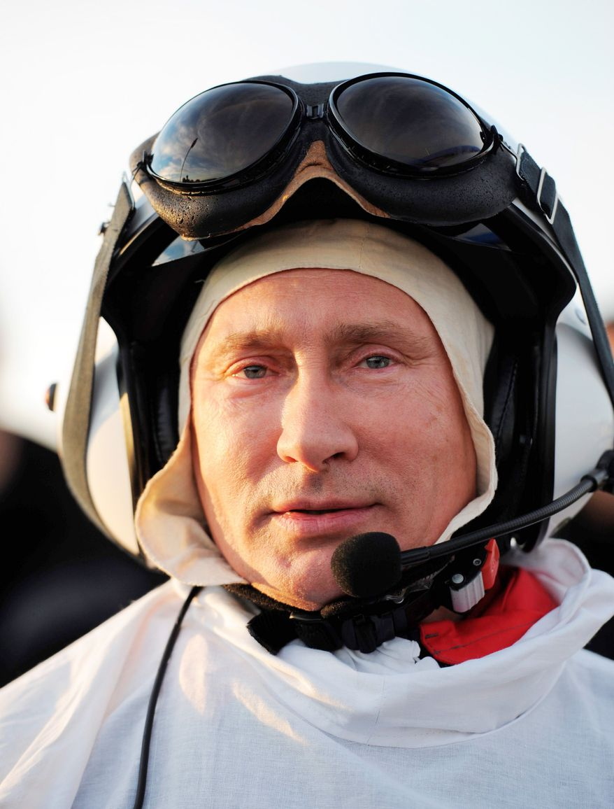 Mr. Putin wore a white crane costume for his flight, the latest in a series of stunts that have included diving for archaeological artifacts, later found to have been planted; riding a horse bare-chested; and flying a fighter jet. (Associated Press)