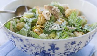 Chunks of chicken and cheese tortellini make Caesar salad more hearty. This version, inspired by cookbook author April Bloomfield, also gets a boy to eat his greens. (Associated Press)