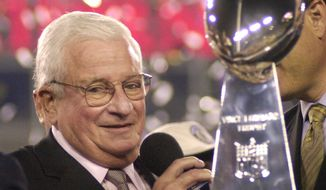 Baltimore Ravens owner Art Modell is pictured with the Vince Lombardi Trophy after the Ravens beat the New York Giants 34-7 in Super Bowl XXXV on Jan. 28, 2001, in Tampa, Fla. (Associated Press)