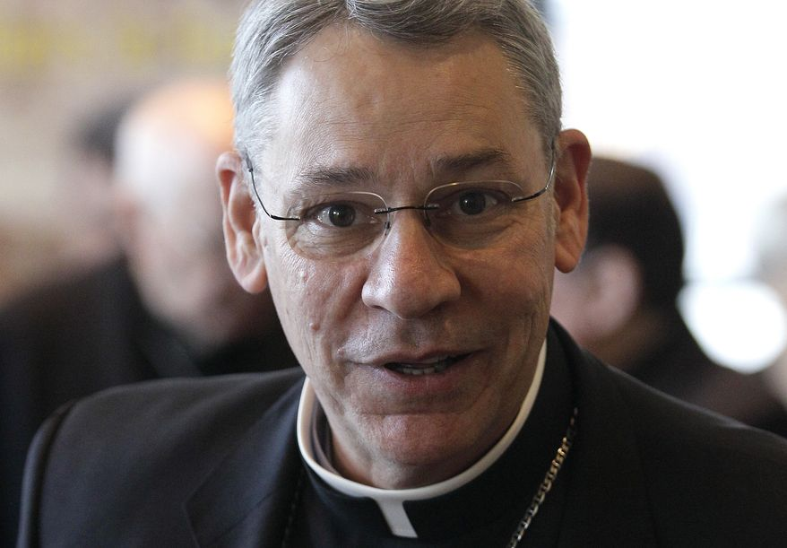 ** FILE ** Bishop Robert Finn of the Catholic Diocese of Kansas City-St. Joseph in Missouri, leaves a meeting at the United States Conference of Catholic Bishops' annual fall assembly in Baltimore on Monday, Nov. 14, 2011. (AP Photo/Patrick Semansky)