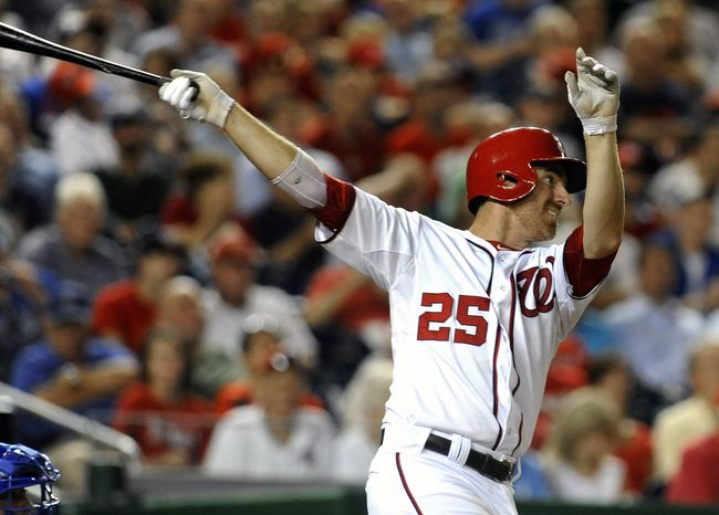 Washington Nationals first baseman Adam LaRoche singles to center field for his third hit during the fifth inning of the Nationals' 9-1 win against the Chicago Cubs at Nationals Park in Washington on Sept. 5, 2012. (Associated Press)