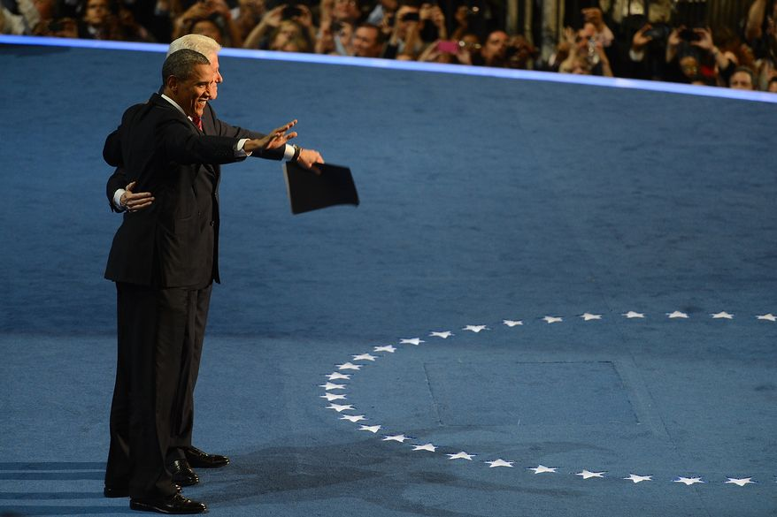 President Barack Obama joins the 42nd President of the United States, after Clinton addressed the Democratic National Convention at the Time Warner Arena in Charlotte, N.C., on Wednesday, September 5, 2012. (Barbara Salisbury/ The Washington Times)