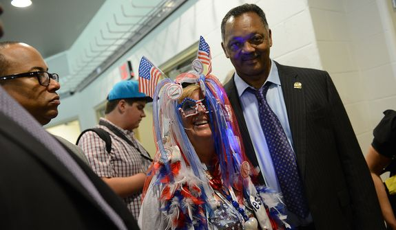 Connecticut delegate Audrey Blondin, of Litchfield, Conn., has her picture taken with Rev. Jesse Jackson at the Democratic National Convention at the Time Warner Arena in Charlotte, N.C., on Wednesday, September 5, 2012. (Barbara Salisbury/ The Washington Times)