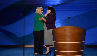 Cristina Saralegui, journalist, actress, and talk show host, left hugs Benita Veliz, DREAM Act activist, at the Democratic National Convention at the Time Warner Arena in Charlotte, N.C., on Wednesday, September 5, 2012. (Andrew Geraci/ The Washington Times)
