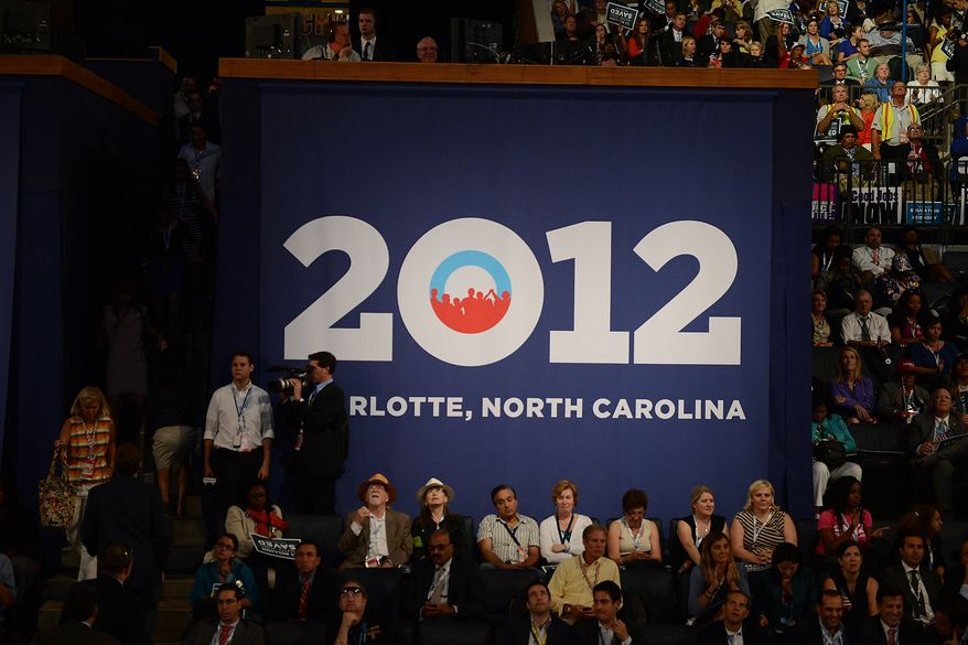Democrats an obstructed view of the stage watch speeches on a large video screen the Democratic National Convention at the Time Warner Arena in Charlotte, N.C., on Wednesday, September 5, 2012. (Andrew Geraci/ The Washington Times)