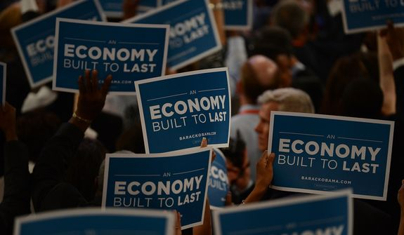 Delegates hold signs touting President Obama's economic policies at the Democratic National Convention at the Time Warner Arena in Charlotte, N.C., on Wednesday, September 5, 2012. (Andrew Geraci/ The Washington Times)