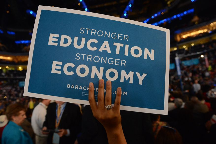 A Democrat delegate holds up a sign during an address the Democratic National Convention at the Time Warner Arena in Charlotte, N.C., on Wednesday, September 5, 2012. (Andrew Geraci/ The Washington Times)