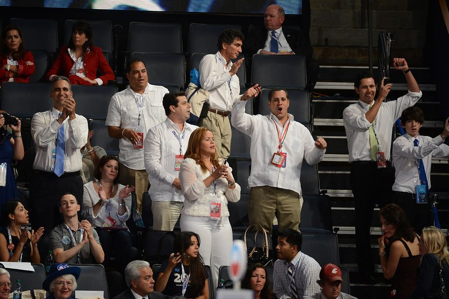 Democrats cheer during an address at the Democratic National Convention at the Time Warner Arena in Charlotte, N.C., on Wednesday, September 5, 2012. (Andrew Geraci/ The Washington Times)