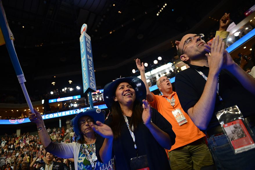 New Mexico delegate Maria Rudolfo, of Farmington, N.M., cheers an address the Democratic National Convention at the Time Warner Arena in Charlotte, N.C., on Wednesday, September 5, 2012. (Andrew Geraci/ The Washington Times)