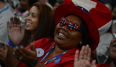 North Carolina delegate Tiffany Powers of Lumberton, N.C., applauds a speech at the Democratic National Convention at the Time Warner Arena in Charlotte, N.C., on Wednesday, September 5, 2012. (Barbara Salisbury/ The Washington Times)