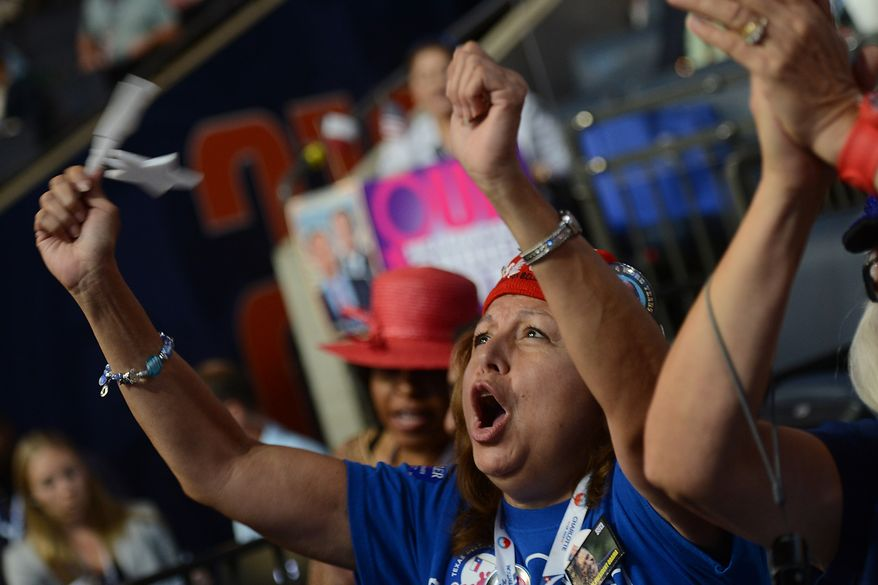 Texas delegate Tina Guerrera, of San Antonio, Tex., cheers a speaker during the Democratic National Convention at the Time Warner Arena in Charlotte, N.C., on Wednesday, September 5, 2012. (Barbara Salisbury/ The Washington Times)