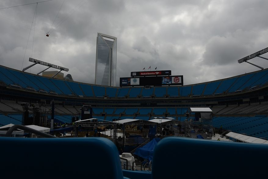 Under stormy skies, work crews begin tear down of sets and lights that would have been used for Thursday's final night of the Democratic National Convention at Bank of America Stadium in Charlotte, N.C., on Tuesday, September 5, 2012. The DNC sited weather concerns for moving President Obama's speech into the Time Warner Arena, while rumors fly that the switch was because the DNC could not fill the stadium.  (Barbara Salisbury/ The Washington Times)