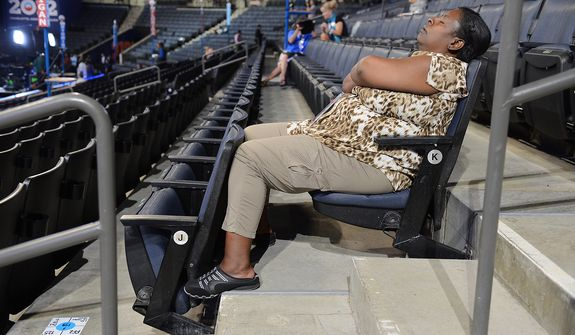 Minnesota delegate Christal Perkins, of St. Paul, Minn. takes a nap as she saves seats for other delegates to watch President Bill Clinton address the Democratic National Convention at the Time Warner Arena in Charlotte, N.C., on Wednesday, September 5, 2012.  (Barbara Salisbury/ The Washington Times)
