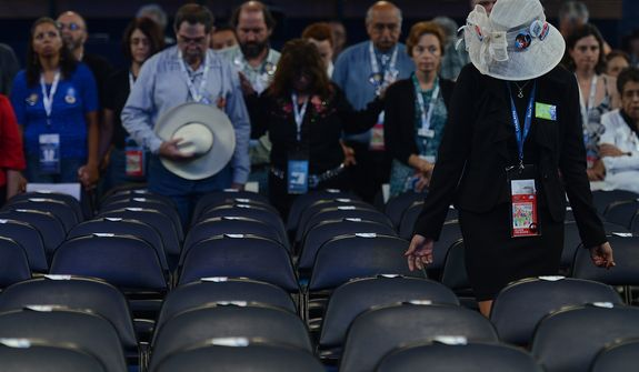 Democrats bow their heads in prayer during the Invocation to open the second day of the Democratic National Convention at the Time Warner Arena in Charlotte, N.C., on Wednesday, September 5, 2012. (Barbara Salisbury/ The Washington Times)
