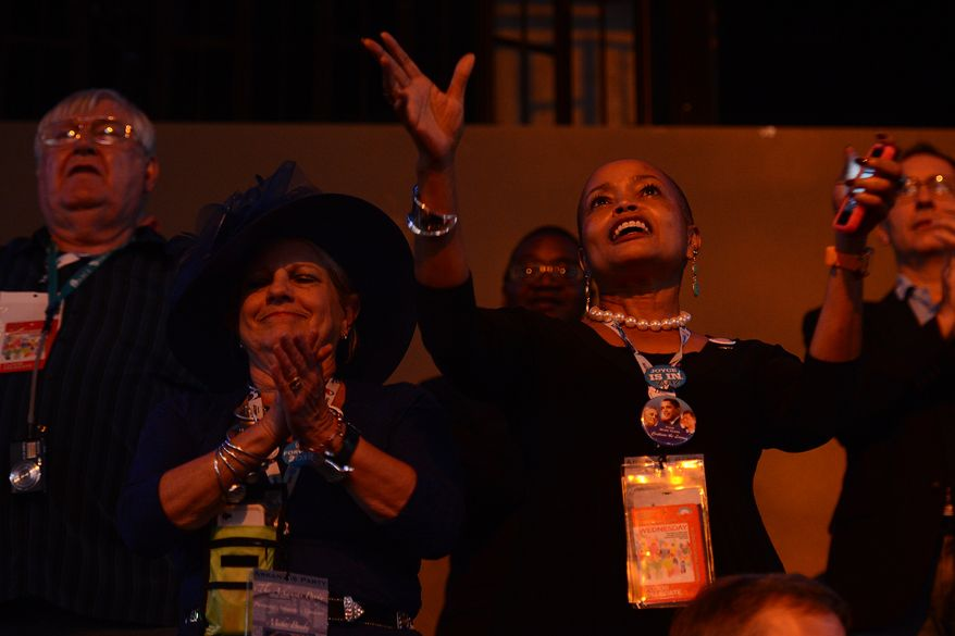 Democrat delegates Janet Johnsn-Henderson, left and Sen. Joyce Elliot of Little Rock, Ark., dance during a performance by Jessica Sanchez at the Democratic National Convention at the Time Warner Arena in Charlotte, N.C., on Wednesday, September 5, 2012. (Barbara Salisbury/ The Washington Times)