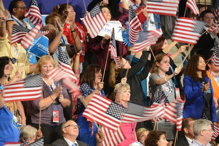The crowd waves flags as President Barack Obama accepts his party's nomination for a second term as President of the United States at the Democratic National Convention in the Time Warner Cable Arena in Charlotte, N.C., on Thursday, September 6, 2012. (Andrew Geraci/ The Washington Times)