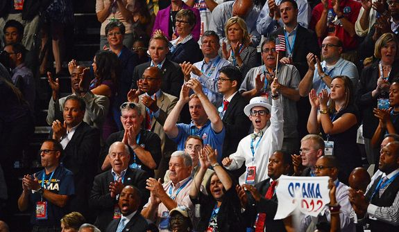 Democrats cheer the speech of Sen. John Kerry, D-Mass., as he voices his support for President Barack Obama at the Democratic National Convention in the Time Warner Cable Arena in Charlotte, N.C., on Thursday, September 6, 2012. (Andrew Geraci/ The Washington Times)