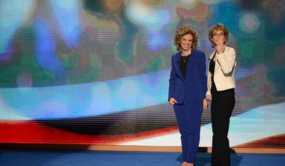 Rep. Debbie Wasserman Schultz, D- Fla., joins former Arizona Congresswoman Gabrielle Giffords in saying the Pledge of Allegiance on the night that President Barack Obama accepts his party's nomination for a second term as President of the United States at the Democratic National Convention in the Time Warner Cable Arena in Charlotte, N.C., on Thursday, September 6, 2012.(Andrew Geraci/ The Washington Times)