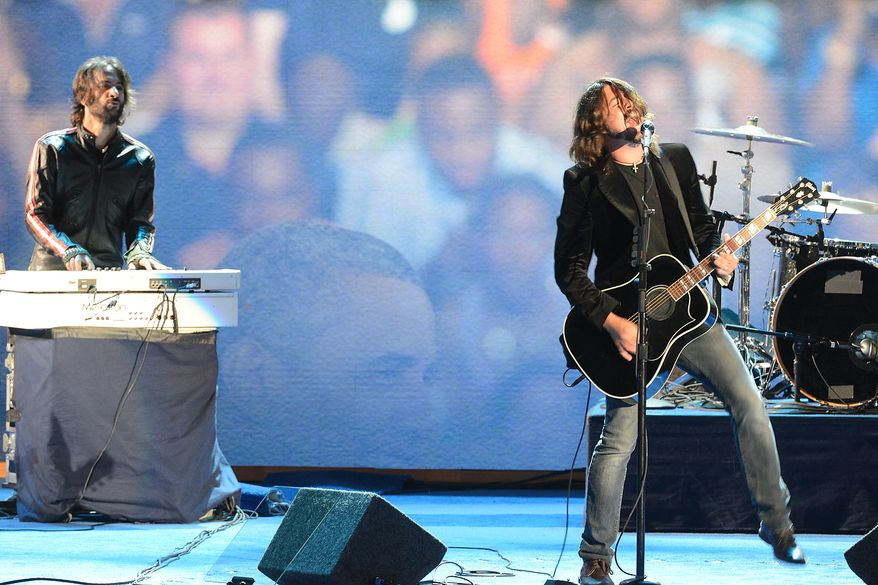 Dave Grohl and the Foo Fighters perform on the night that President Barack Obama accepts his party's nomination for a second term as President of the United States at the Democratic National Convention in the Time Warner Cable Arena in Charlotte, N.C., on Thursday, September 6, 2012. (Andrew Geraci/ The Washington Times)
