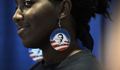 Shawanna Black of Charlotte, N.C., wears earrings made by her sister who also volunteered four years ago, on the night that President Barack Obama accepts his party's nomination for a second term as President of the United States at the Democratic National Convention in the Time Warner Arena in Charlotte, N.C., on Thursday, September 6, 2012. (Barbara Salisbury/ The Washington Times)