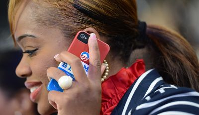 Florida delegate Tamel McKinney talks on her cell phone on the night President Barack Obama accepts his party's nomination for a second term as President of the United States at the Democratic National Convention in the Time Warner Arena in Charlotte, N.C., on Thursday, September 6, 2012. (Barbara Salisbury/ The Washington Times)