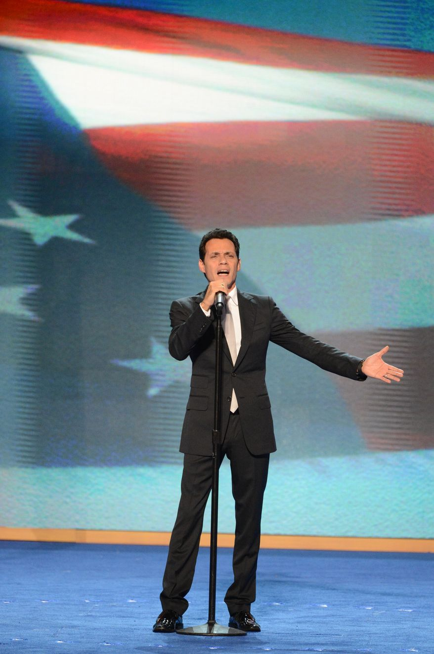 Recording artist Marc Anthony sings the National Anthem on the last night of the Democratic National Convention. (Andrew Geraci/ The Washington Times)